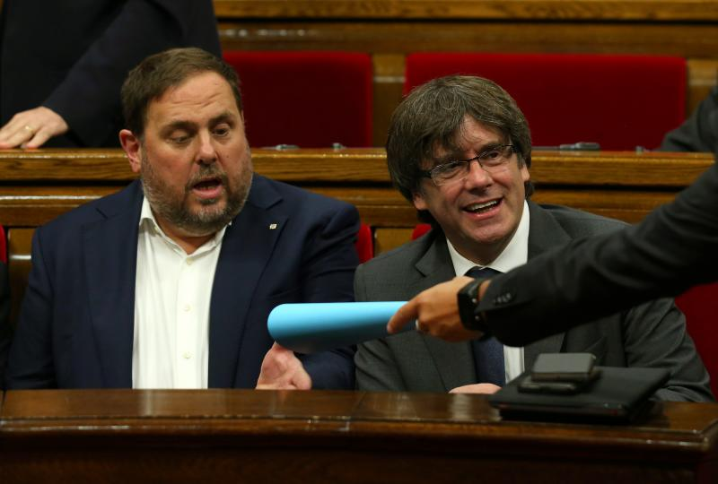 Catalan regional President Carles Puigdemont (R) and and vice president Oriol Junqueras attend a session of the Catalonian regional Parliament in Barcelona, Spain, September 6, 2017. REUTERS/Albert Gea